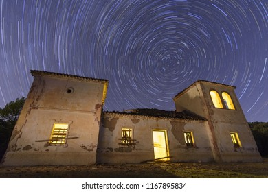 Star trail over old building