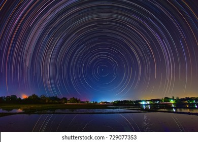A star trail is a type of photograph that utilizes long-exposure times to capture the apparent motion of stars in the night sky due to the rotation of the Earth.