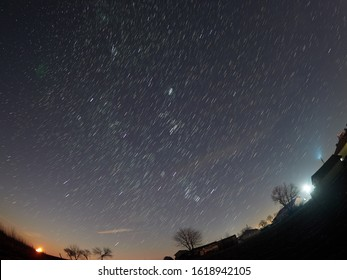 Star trails with the moonset in the left side