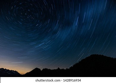 star trails with mountain in switzerland