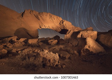 Star trails night landscape of a volcanic Rock arch in Tenerife, Canary island, Spain.
