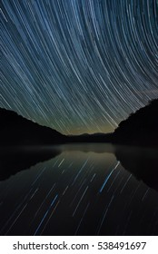 Star trails over calm waters in the Appalachian Mountains