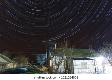 Star trails over the village house