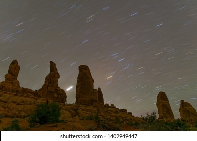 Star trails sweeps across landmarks in Arches National Park.