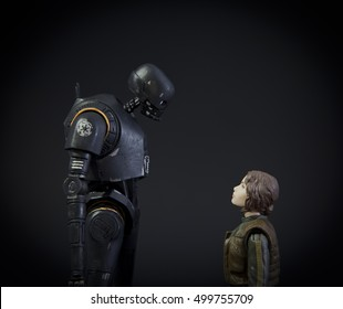 Star Wars Rogue One characters Jyn Erso played by Felicity Jones and the Droid K-2SO - using Hasbro Black Series 6 inch action figures - studio shot
