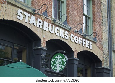 Starbucks Logo And Front Entrance - TORONTO, CANADA - July 13, 2017