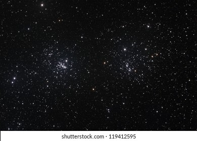 Starfield with The Double Cluster (Cadwell 14) in the constellation of Perseus formed by two open clusters NGC 884 and NGC 869. - Shutterstock ID 119412595