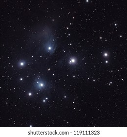 Starfield with The Pleiades (Seven Sisters or Messier M45), an open star cluster in the constellation of Taurus. 100mm refractor telescope and about 15min of exposure time.