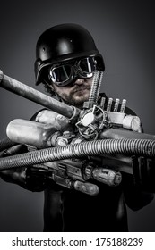 Starfighter with huge plasma rifle, fantasy concept, military helmet and goggles motorcyclist. airsoft