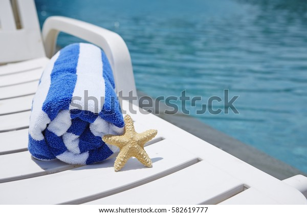 Starfish and beach chair at poolside