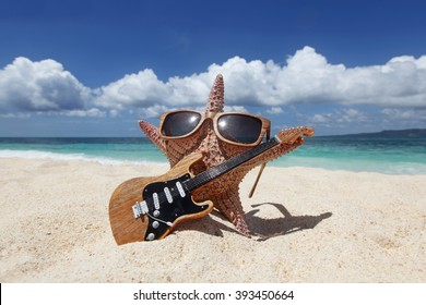 Starfish guitar player on sand of tropical beach at Philippines