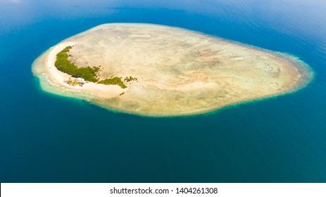 Starfish Island, Puerto Princesa, Palawan. Island hopping Tour at Honda Bay, Palawan. An island of white sand with mangroves. Atoll with a white island, view from above.