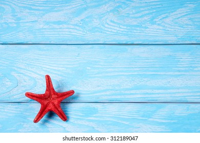 Starfish on blue textured boards