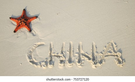 Starfish on the sand beach with China sign flag shaped, communism in South China Sea