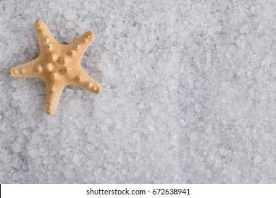 Starfish on sea salt. Crystals of sea salt.