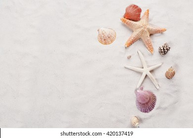 Starfish and seashell on the beach. Summer holiday relaxing seaside top view.