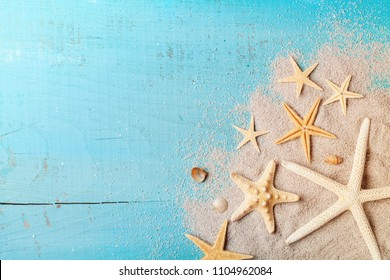 Starfish and seashell on sand for summer holidays and travel background.