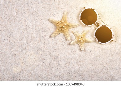 Starfish and sunglasses on the beach, Summer accessories.