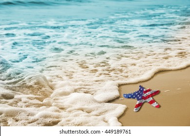 Starfish with USA flag on the sandy beach for Labor day concept