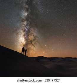 Stargazers at Great Sand Dunes National Park looking at the Milky Way Galaxy.