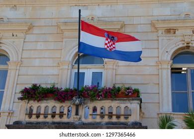 STARI GRAD, CROATIA - August 21, 2018: Flag of Croatia in town of Stari Grad  in Hvar, Croatia
