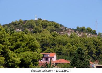 STARI GRAD, CROATIA - August 21, 2018: Hill with cross in town of Stari Grad  in Hvar, Croatia
