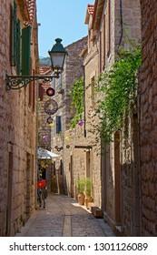 STARI GRAD, CROATIA - August 21, 2018: Beautiful street in  old town of Stari Grad  in Hvar, Croatia
