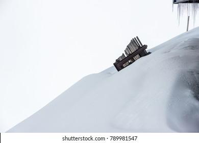 A stark snow landscape with stalactite formation at Schilthorn, Switzerland.
