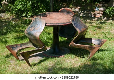 Starkow, Germany - May 29, 2018: A table and 3 Moeckl chairs, called kangaroo, squatting man or Z chairs