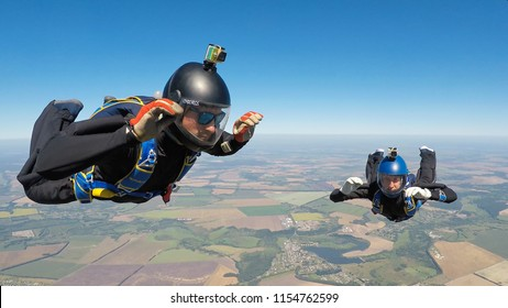 STARODUB/RUSSIA - August 11, 2018:  Two skydivers in the air