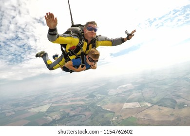 STARODUB/RUSSIA - August 4, 2018: Skydiving tandem master with the young boy passenger in the sky