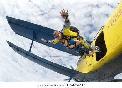 STARODUB/RUSSIA - August 4, 2018: Skydiving tandem master with the young boy jumping out of the plane