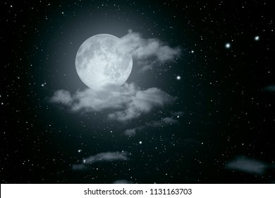Starry full moon night sky with some clouds. Used part of a NASA photo for the stars.