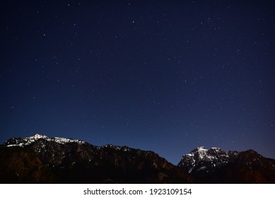 Starry night in the alpine mountains.