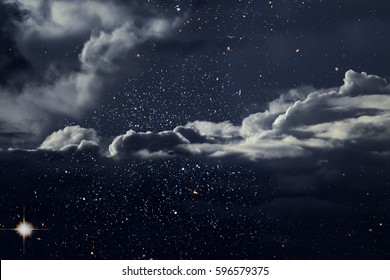 Starry night with interesting clouds.