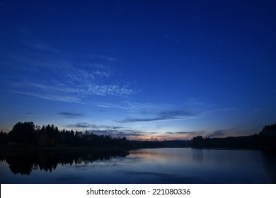 Starry night landscape near the lake