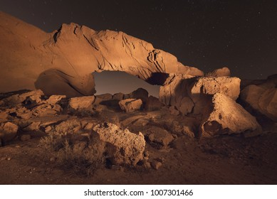Starry night landscape of a volcanic Rock arch in Tenerife, Canary island, Spain.