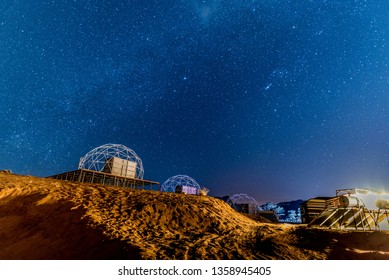 Starry night with Martian dome in a desert camp in Wadi Rum, Jordan