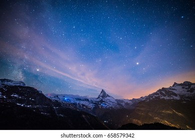 Starry night with Matterhorn peak, Zermatt, Switzerland.