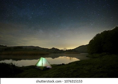 starry night on wild camp by the lake in Nebrodi Park, Sicily