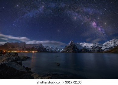 Starry Night. Our home galaxy over the the village of Hamnoy in the circle arctic of Norway.
