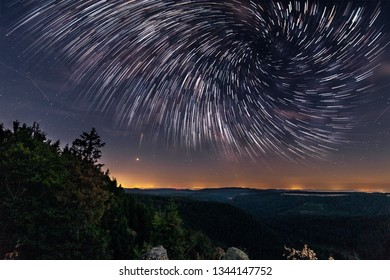 Starry night over the cliffs of the Harz mountains