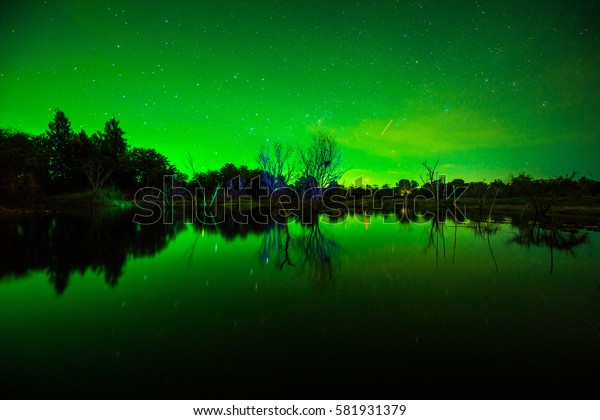 Starry night sky with aurora polaris over the mountains ,  Dark night sky beautiful green