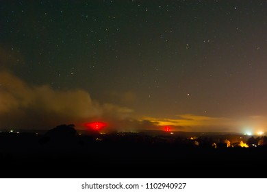 Starry Night Sky and Low Clouds Over Rural Villages