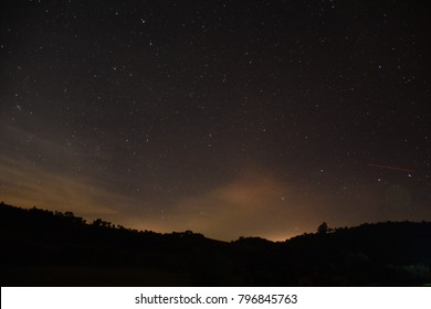 Starry night sky with mountain silhouette