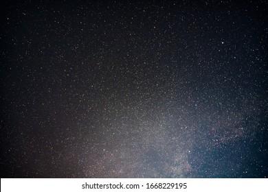 Starry night sky on a moonlit night.