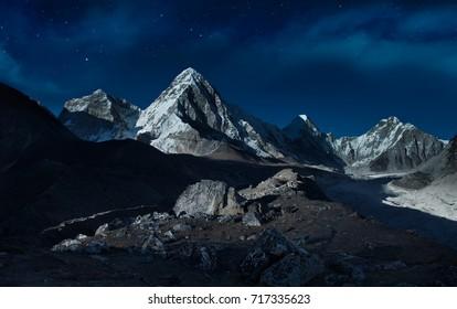 Starry night sky over the mountains,Pumori peak (7161 m), Himalayas,Nepal
