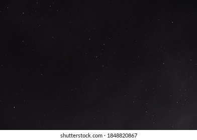 Starry Night Sky with some Clouds
