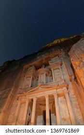 Starry night sky and the Treasury of Petra, Jordan