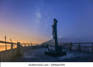 Starry Night View of Silhouette Jesus on Cross At the Hilltop of Virgin Mary Historical Trail of Jiaosi, Yilan, Taiwan